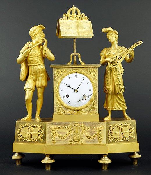 A 19th Century French Empire Gilt Bronze Clock.