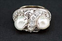A Diamond, Baroque Pearl, and 14 Karat White Gold Ring.