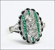 An Art Deco Platinum Diamond and Emerald Ring