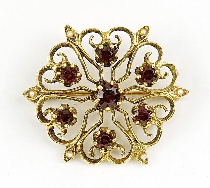 A Victorian Garnet And 14 Karat Yellow Gold Brooch.