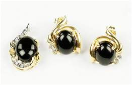 An Onyx Diamond and 14 Karat Yellow Gold DemiParure