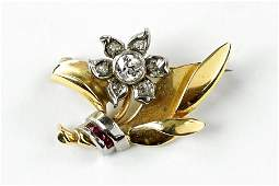 A Diamond Ruby And 14 Karat Yellow Gold Flower