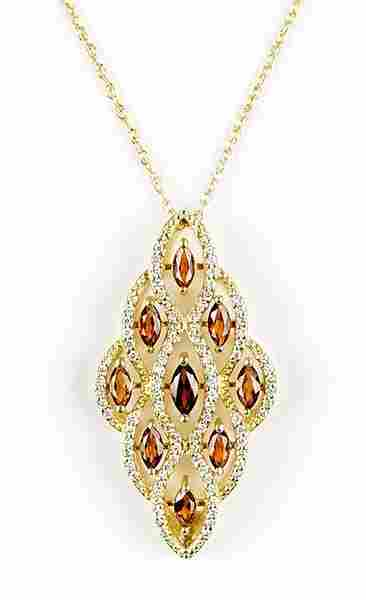 A Diamond, Garnet, And 14 Karat Yellow Gold Necklace.