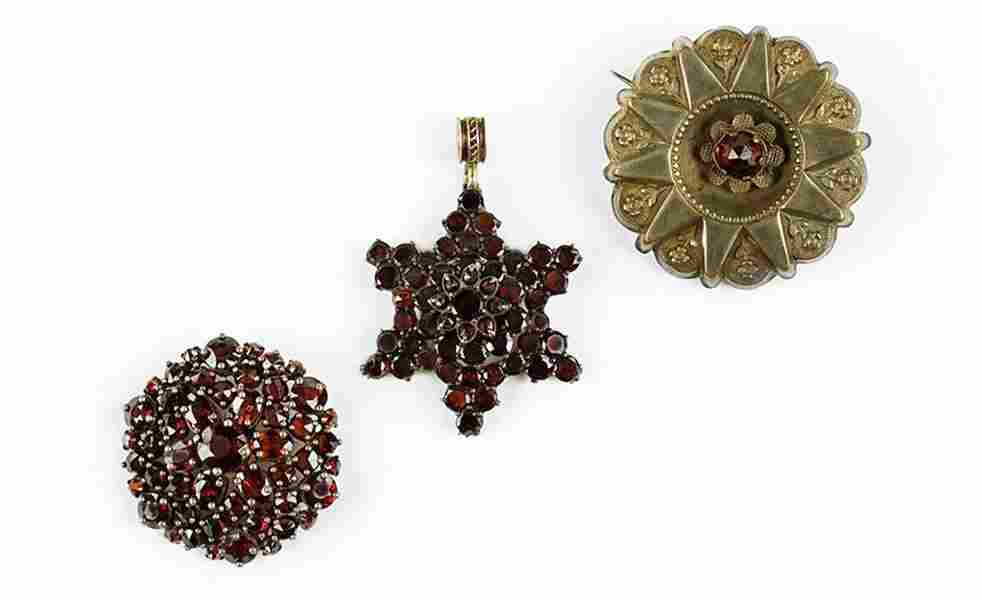 A Victorian Garnet And Sterling Silver Brooch.