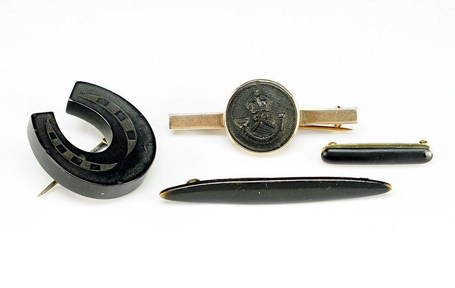 An Edwardian Vulcanite And 9 Karat Yellow Gold Bar Pin.