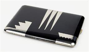 A Black Enamel And Silver Art Deco Cigarette Case.