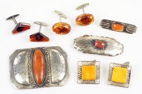 Three Pairs Of Amber Cufflinks.