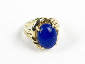 A Lapis And 14 Karat Yellow Gold Ring.