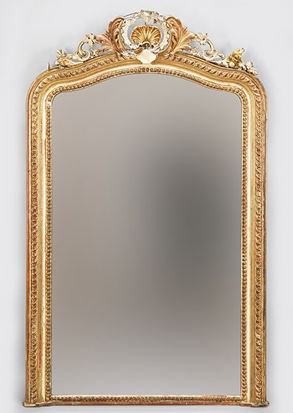 A French Louis XIV Style Carved Giltwood Mirror.