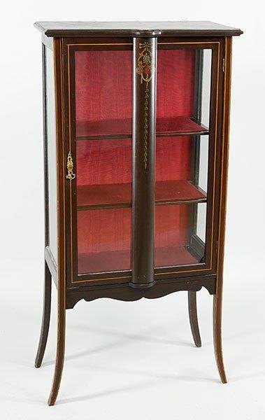 A Victorian Ebonized Wood Vitrine.