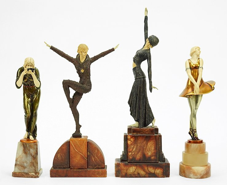 Four Art Deco Style Figures.