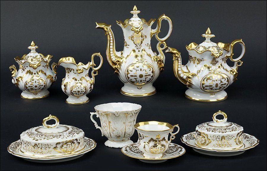 A German Gilt Porcelain Tea and Coffee Service.