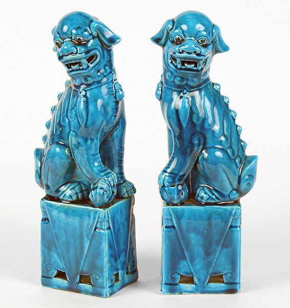 A Pair of Chinese Blue Glazed Ceramic Foo Lions.