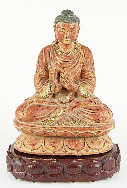 A Thai Carved Wood Seated Buddha.