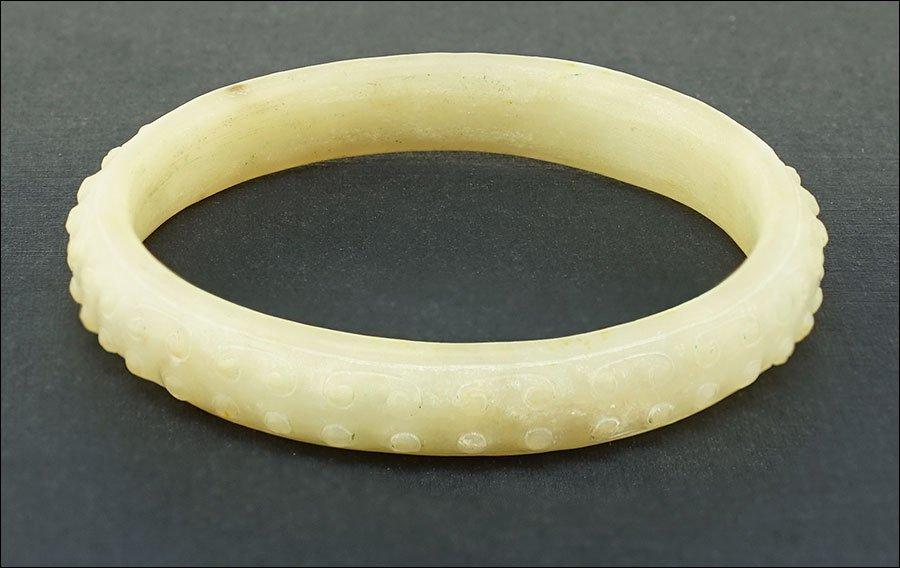 A Carved Jade Bangle Bracelet.