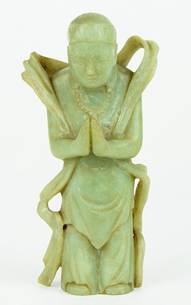 A 17th Century Green Jade Figure of a Budha Acolyte.