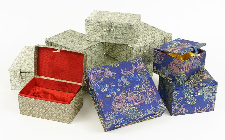 A Collection Of Nine Chinese Silk Lined Boxes.