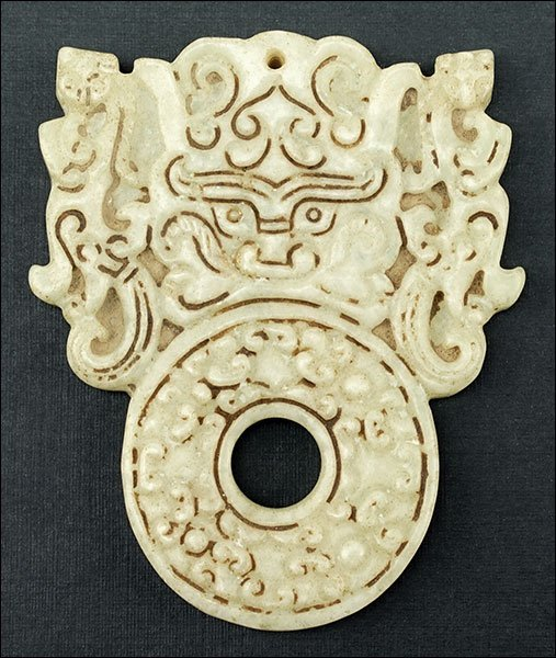 A Carved Jade Pendant.