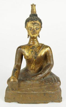 A 16th Century Thai Gilt Bronze Seated Buddha.