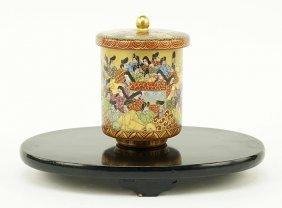 A Japanese Kutani Porcelain Tea Cup.