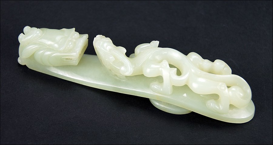 A Chinese Qing Period Carved Celadon Jade Belt Hook.