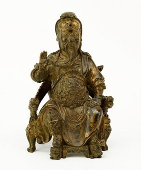 A Chinese Patinated Bronze Seated Figure Of An Elder.