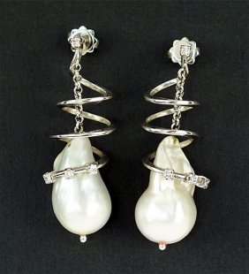 A Pair Of Pearl, Diamond And 18 Karat White Gold