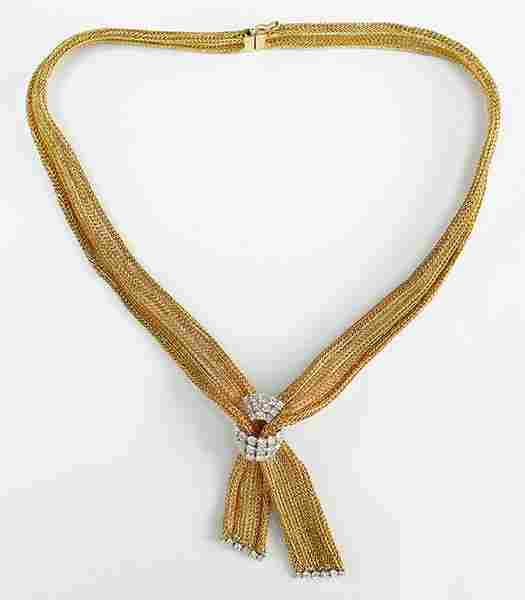 A Diamond and 14 Karat Yellow Gold Necklace.