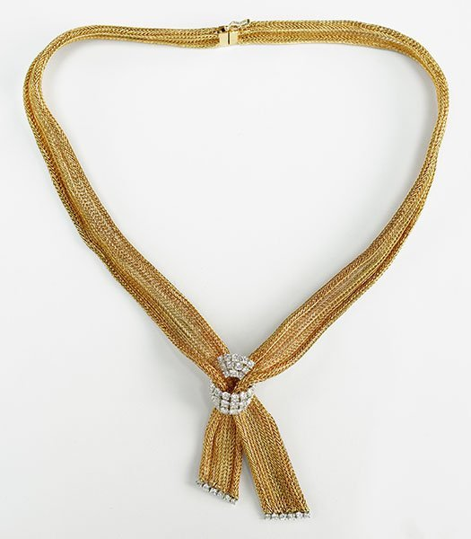 A Diamond and 14 Karat Yellow Gold Necklace.