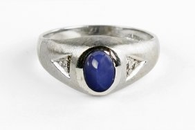 A Star Sapphire, And 10 Karat White Gold Ring.