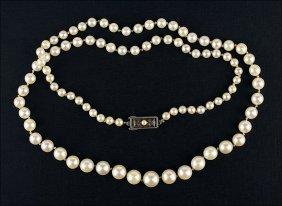 A Single Strand Of Mikimoto Graduated Cultured Pearls.