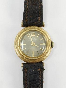 A Bulova 14 Karat Yellow Gold Watch.