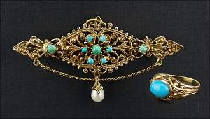 A Turquoise and 14 Karat Yellow Gold Brooch / Pendant.