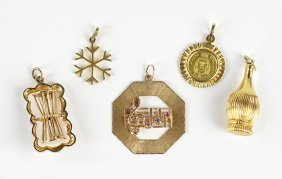 A Collection Of Five Yellow Gold Charms.