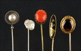 A Collection Of Four Gold Stick Pins.