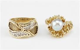 Two 14 Karat Yellow Gold Rings.
