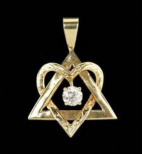 A Diamond And 14 Karat Yellow Gold Pendant.