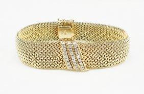 A Lady;s 14 Karat Yellow Gold Movado Surprise Watch.