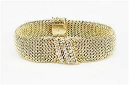 A Ladys 14 Karat Yellow Gold Movado Surprise Watch
