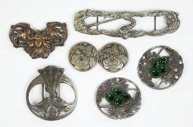 A Collection Of Four Art Nouveau Belt Buckles.