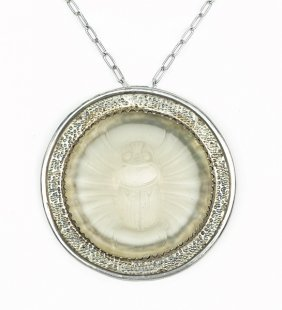An Egyptian Revival Frosted Glass Scarab Pendant.
