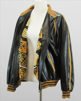 A Battaglia Black And Tan Leather Jacket.