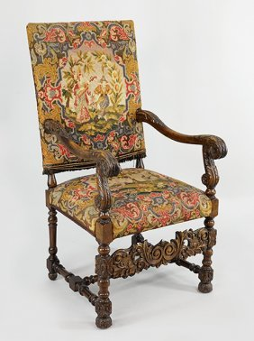 A Continental Carved Mahogany Open Armchair.