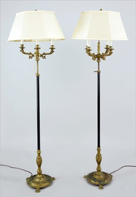A Pair Of Brass And Patinated Metal Four-light Floor