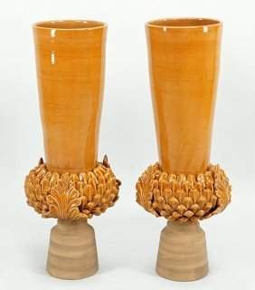 A Pair Of Glazed Ceramic Vases.