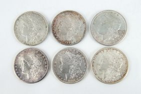 Six Morgan Silver Dollars.