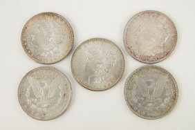 Five Morgan Silver Dollars.