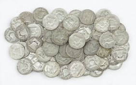 A Collection Of 62 Franklin Half Dollars.