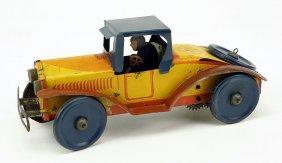 A Marx Windup Tin Car.