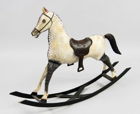A Painted Metal Rocking Horse.